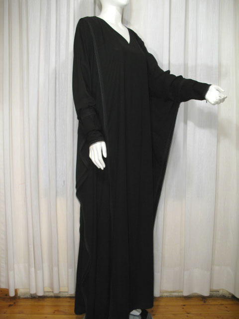 Butterfly style abaya known as malhafa sleeves are narrowed at end