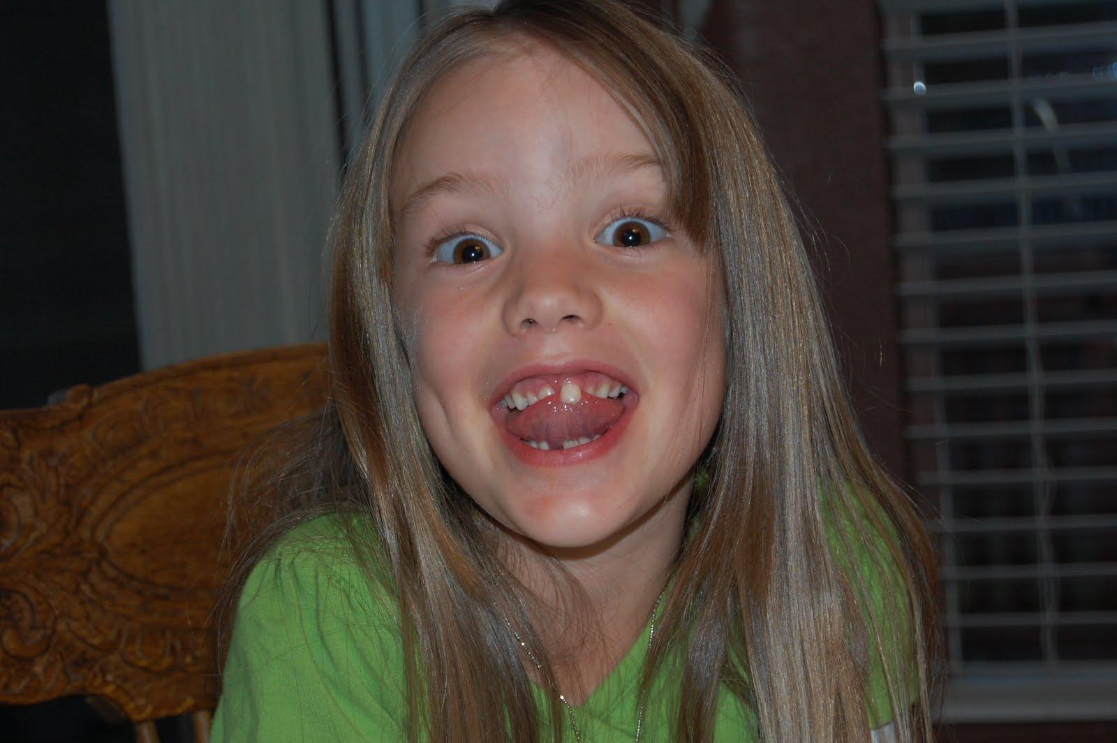 little girl open tongue