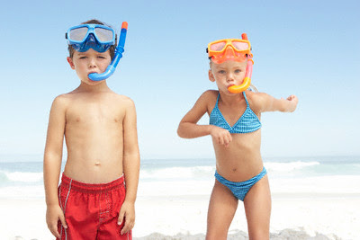 Boy and girl wearing swim masks. Collection of Bikini Underwear.