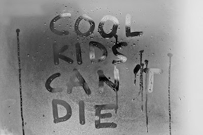 Cool Kids Can Not Die written on frosted mirror