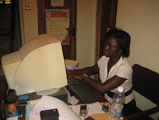 Tinuke, Small Business Enterprise Worker, working in the ICL office...