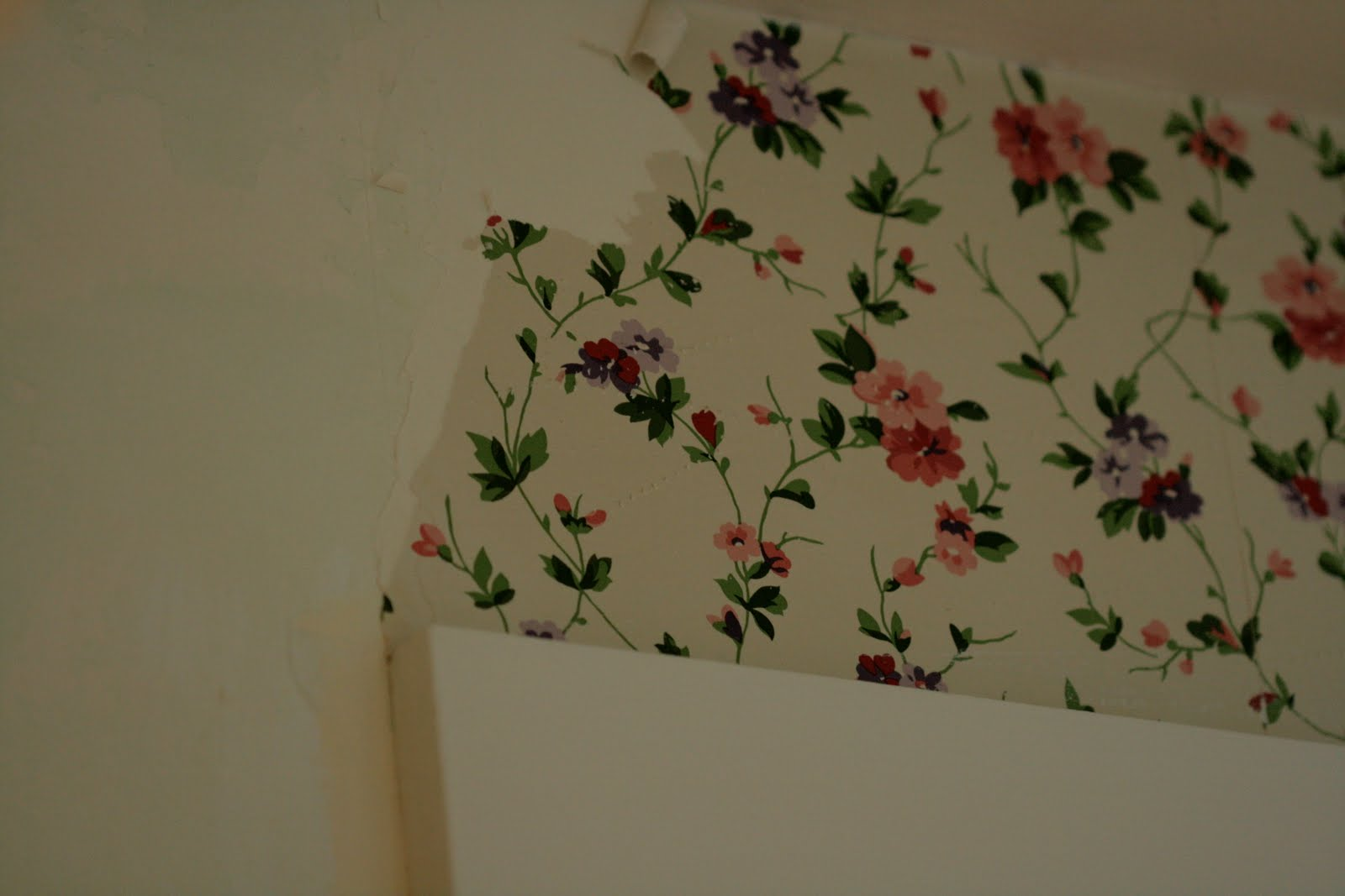 The top layer has a certain Laura Ashley charm. The wallpaper could have