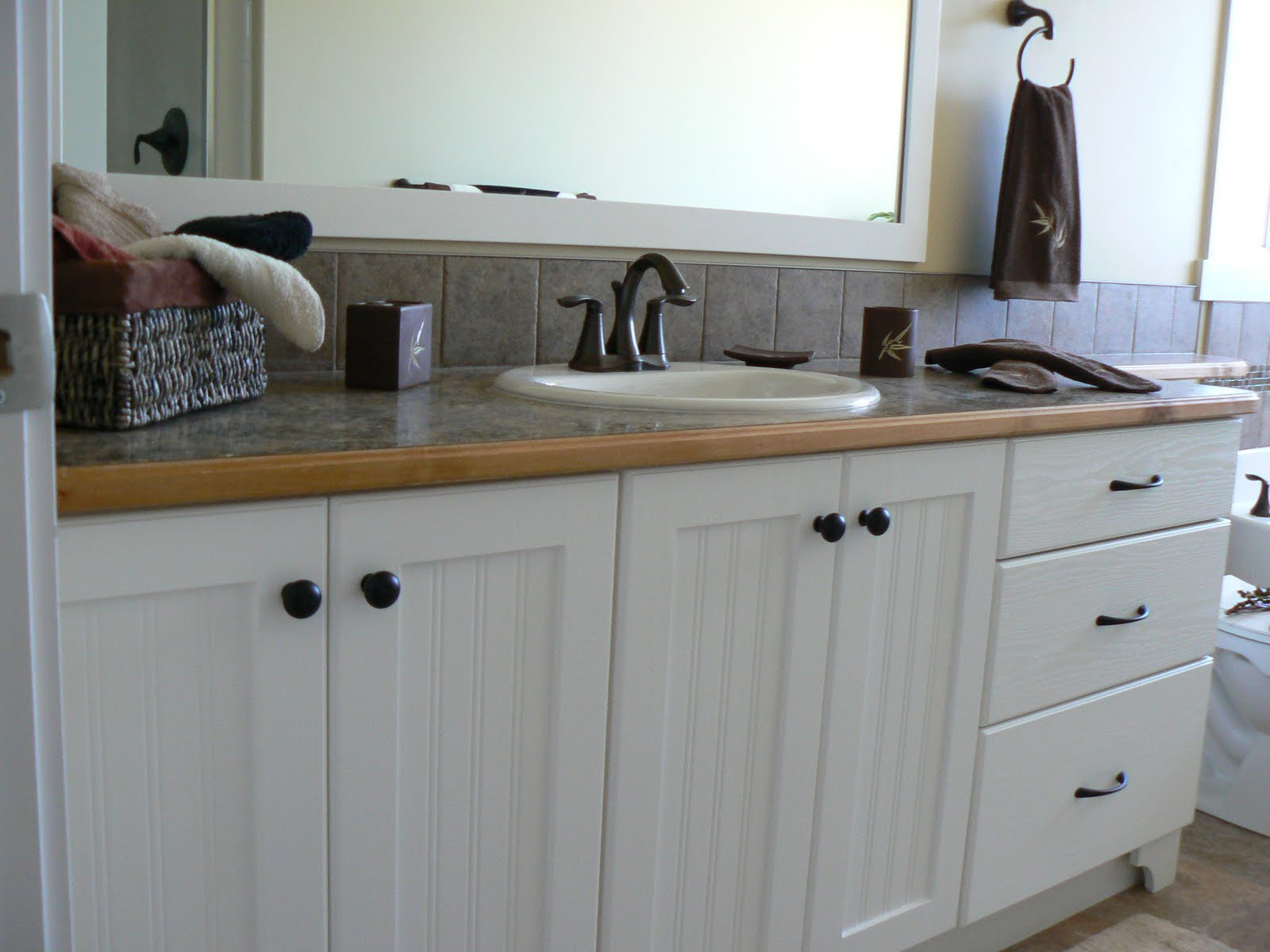 ensuite with large vanity and bank of drawers