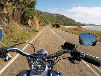 Photo of a motorcycle moving down a road