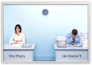 Photo of a woman and a man sitting at desks.