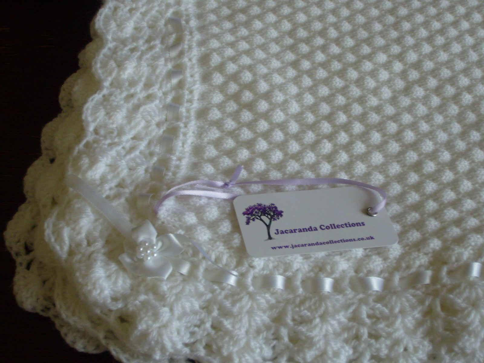 Crocheting Edges On Baby Blankets : Jacaranda Collections: Machine knitted tuck blanket with crochet edge