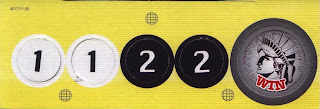 Front of tokens from Batman Forever game