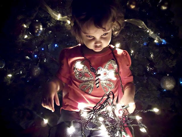Afton looking down at Christmas lights