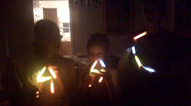 Creative kids in Arlington, Virginia spelling out AAC with glow sticks