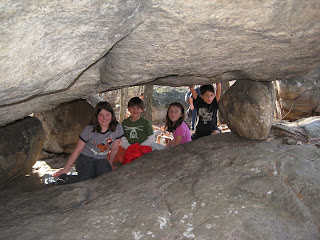 Kids under Tripod Rock