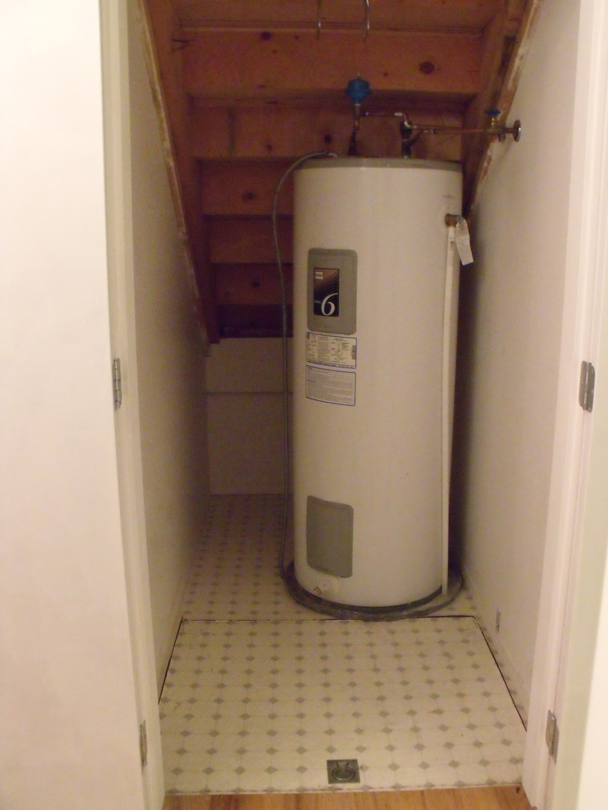 Water Tank Stairs : Home thoughts from a broad the cupboard under stairs