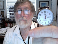 John Strange holding watch that shows time is almost up