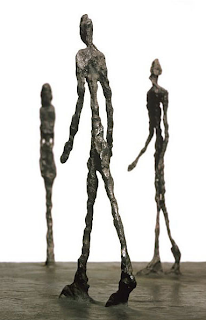 Giacometti sculpture of three human figures
