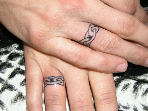 Wedding Ring Tattoos. A tattooed wedding ring can be a beautiful design
