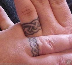 tribal tattoos designs wedding ring tattoos the ultimate symbols of love. Black Bedroom Furniture Sets. Home Design Ideas