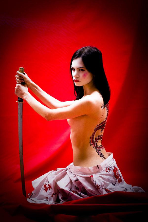 Woman Yakuza with Japanese Dragon Tattoo