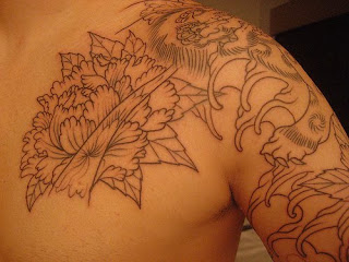 Flower Tattoo Design on Upper Side Man