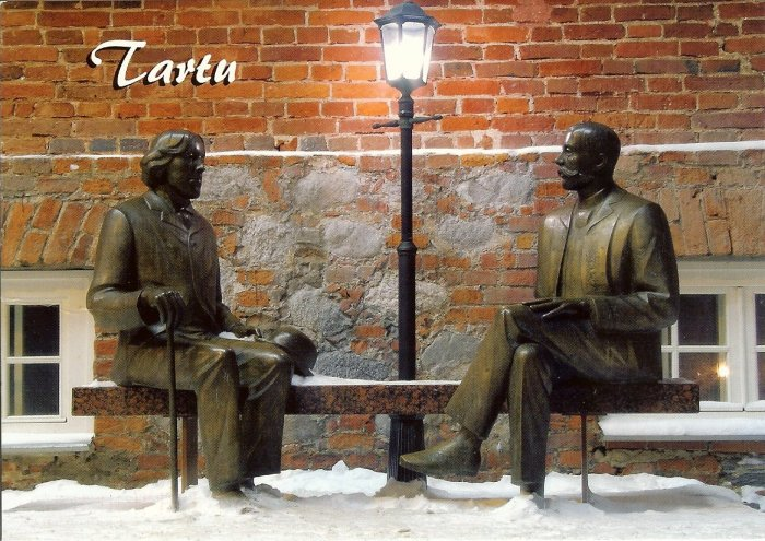 statue of Oscar Wilde and Eduard Vilde sitting on a bench in Tartu Estonia