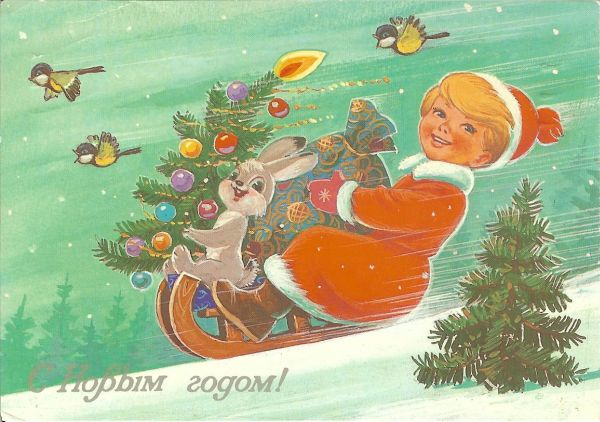 girl in santa costume on sled with rabbit and Christmas tree