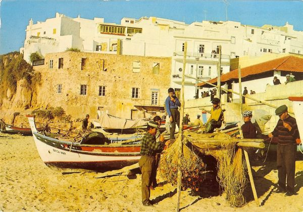 fishermen and boats on beach