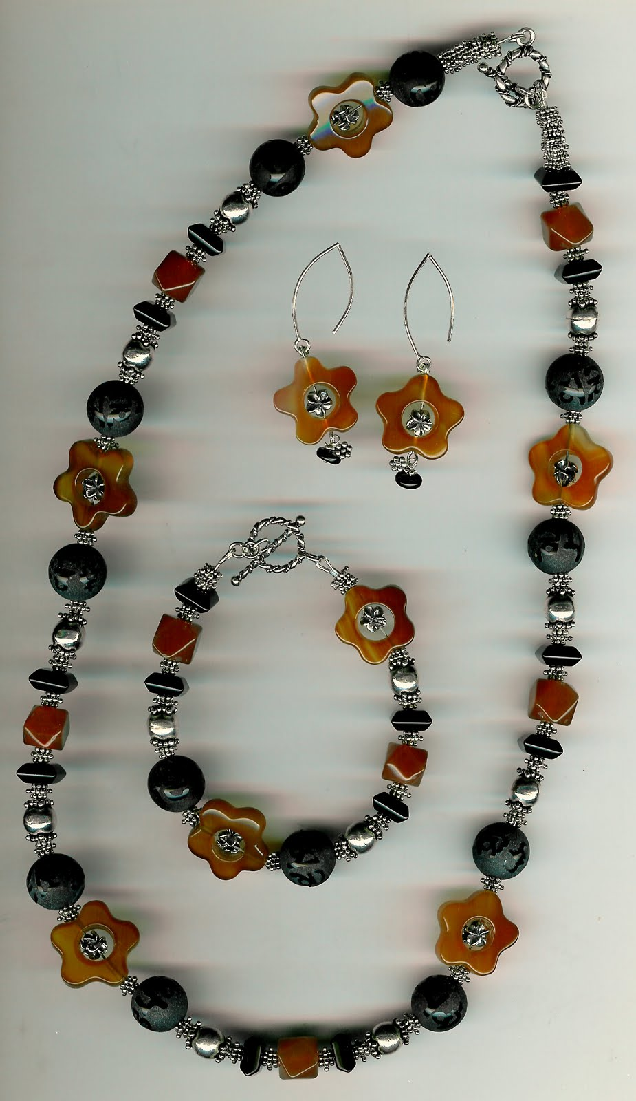 202. Carved Carnelian, Black Onyx with Bali Sterling Siver + Bracelet and Earrings
