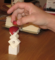 The picture doesn't show the tension on the players face and the quivering hand as he tries to place the next object in a game of Bausack