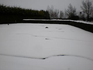 The snowed under Crazy Golf course at Tea Green Golf, Wandon End, Luton