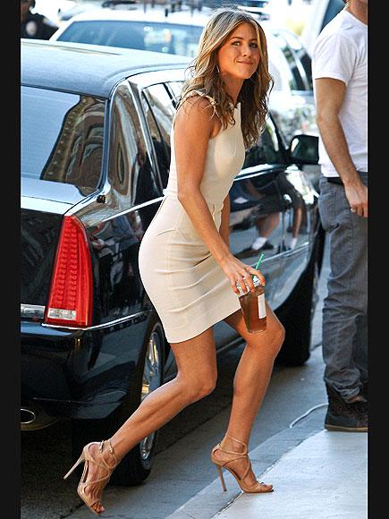 Jennifer Aniston in White Dress. She's got legs!