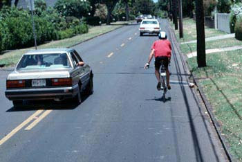 Image of motorist passing a bicyclist