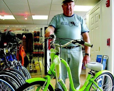 Idle Times inventory manager Donald Watson holds one of the new bike designs that emphasize comfort and style.