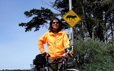 Image of bicyclist in front of coyote sign in San Francisco