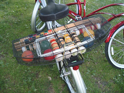 Image of bike with crocquet mallets in Sacramento's McKinley Park