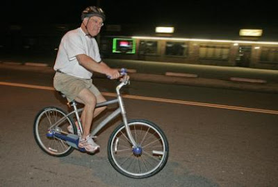 Image of Boston Mayor Thomas Menino riding a bicycle