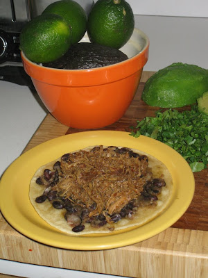 Pile shredded pork on top of black beans
