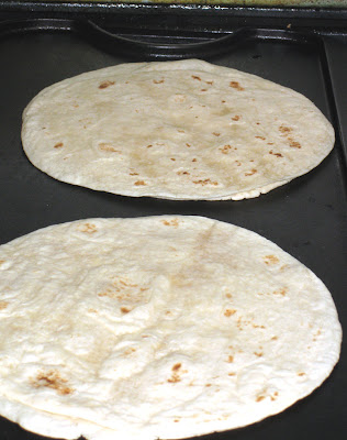 Heat flour tortillas on a griddle