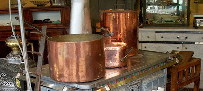 Copper pots and 19th-century stoves in good working order (detail).