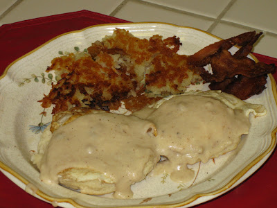 Pops O'Food biscuits and gravy with eggs, bacon and hashbrowns