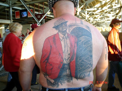 "He had requested a ""small, tasteful, 'Go War Eagle!'"" tattoo but, arriving"