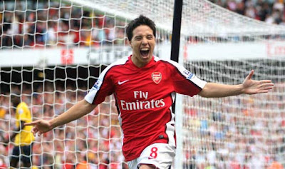 Arsenal's Samir Nasri is overjoyed after scoring on his Premier League debut, against West Bromwich Albion in the season opener.