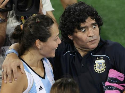 Diego Maradona with a member of the Argentine women's team at the Beijing Olympics.