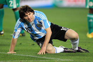 Lionel Messi of Argentina's national football team picks himself up off the pitch during 2010 FIFA World Cup South Africa Group B, Match between Argentina and Nigeria at Ellis Park Stadium on June 12 in Johannesburg, South Africa.