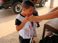 a little boy receives a shirt