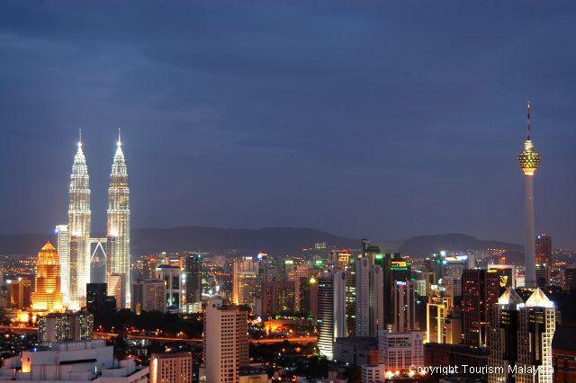 Kuala Lumpur night skyline with Petronas Twin Tower on the left and Menara Kuala Lumpur