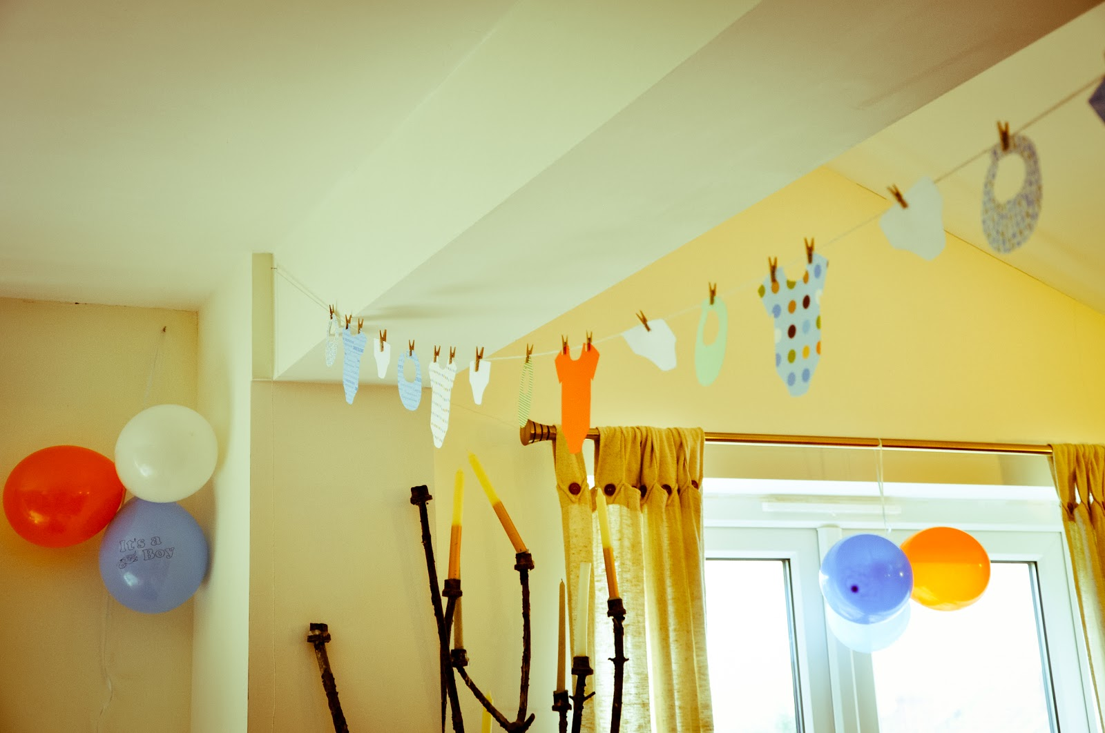 See by chloe diy baby shower clothesline bunting for Baby shower ceiling decoration ideas