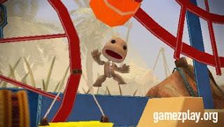 sackboy jumping with ferris wheels behind
