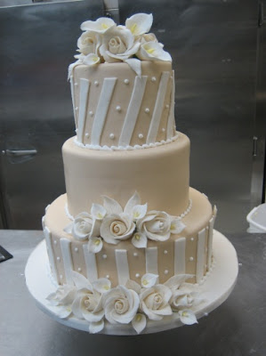 This is a very modern style wedding cake with handmade sugar roses.