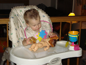 Halle feeding her baby