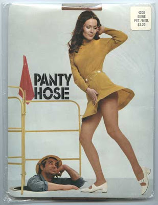 Panty hose package with woman in short dress flaring up while man in hardhat, down in a manhole, looks up her skirt