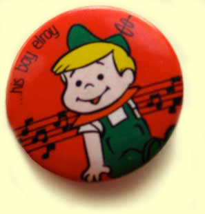 Red button with Elroy Jetson on it, label His Boy Elroy