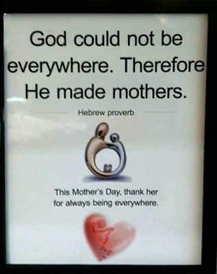Advertising placard with a silver and gold looking abstract pin and the headline, God could not be everywhere. Therefore He made mothers